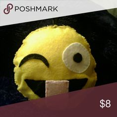 Winking emoji pillow Small handmade winking emoji pillow plush. Has a little loop on top to hang it. I hand sewed all of this but don't worry I made sure it has lots of durability. Made from felt. Tagged as Urban Outfitters for advertisement. Also the price is due to the supply cost and time put into it. I spent at least 2 hours on this. Urban Outfitters Other