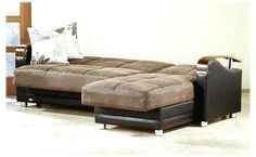 Sofa Bed Brown Color With A Nice Design And Very Attractive, With Two White Pillows On The Couch