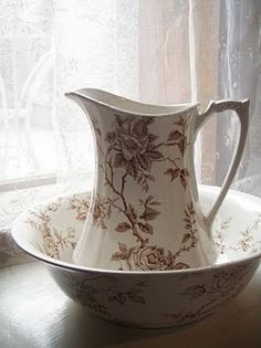 Beautiful brown floral pitcher and bowl.
