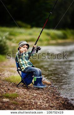 little boy fishing photography | photo of little boy fishing - stock photo