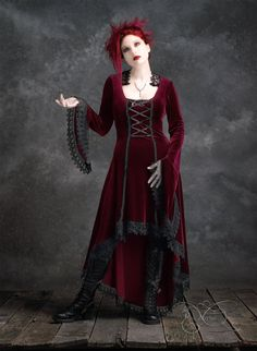 The Lavande Gown creates a strikingly vampyric vision in velvet and Venice lace. The design features a dramatically arched front hemline, floor length