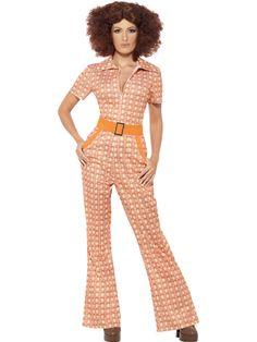 70-luvun haalarityttö. Vuosikymmenen tyyliin kuvioitu haalari on hauska ja tyylikäs naamiaisasu, johon kuuluu oranssi vyö.