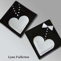 """A set of 7""""-square fused plates. The bride motif features a pearl necklace and 5"""" heart, and the groom design includes the heart plus a bow tie and shirt studs. Small glass squares are fired to create the pearls and studs, and the design is tack-fused to finish."""