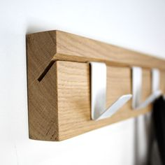 Recycled wood. Hooks slide along in this simple yet practical design.