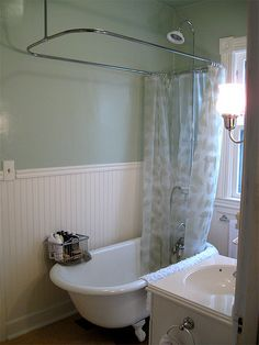 refinished clawfoot tub with shower kit by tofupunk via flickr