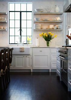 Love the dark floors with white cabinets! Open shelves are amazing. Love this kitchen!