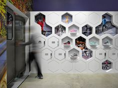 Inside the Mapos-designed Asics store in New York, custom lockers allow customers to store their belongings while taking products on a test run in nearby Central Park. #interiordesign #interiordesignmagazine #design #projects #retail