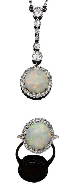 An early 20th century opal and diamond pendant necklace and ring suite The circular opal cabochon, within a single-cut diamond surround, suspended from a later line of graduated old brilliant and single-cut diamonds in collet-settings, millegrain-set throughout, to a later 9 carat white gold trace-link chain