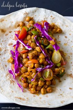 Vegan Chickpea Burritos - garbanzo beans, coconut/olive oil, white onion, bell pepper, zucchini, cumin, paprika, cayenne pepper, garlic powder, sea salt, cabbage, grape tomatoes, tortillas