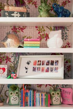 Wallpapering the bookshelves is a great way to add dimension and interest to the backdrop of a shelf. #designideas