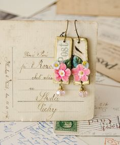 These vintage postcard earrings by Holly Kennedy are signed, sealed, and delivered inside GreenCraft Magazine.