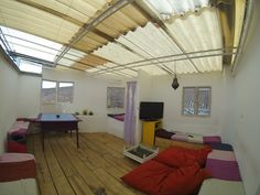 Roof terrace with nice views of the city, TV with a 500 movies cataloge and a nice area for playing games.