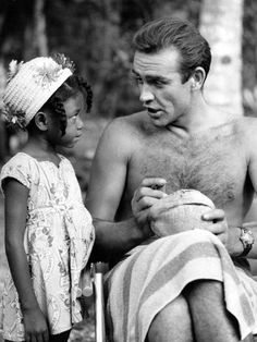 Sean Connery autographing a coconut for a Jamaican girl on the set of Dr. No