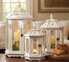 A trio of charmingly lovely shabby chic gazebo inspired lanterns.nice for porch.or christmas. White Lanterns, Wooden Lanterns, Lanterns Decor, Candle Lanterns, Vintage Lanterns, Flameless Candles, Candle Wax, Diy Candles, Shabby Chic Homes