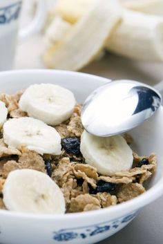 Combine 3/4 cup bran flakes, 1 banana and 1 cup fat-free milk in a bowl.