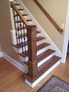 Thomas...check this one....metal spindles, square baluster, wood treads, white painted risers, wood banister.  I like this look.