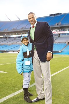 """Cam Newton hosted eight patients from Levine Children's Hospital for Sunday's Raiders game for the second annual """"Christmas with Cam"""" day. The children watched the win from a suite at Bank of America Stadium and were visited by Santa Claus and the Top Cats. After the game, they met Cam and received personalized #1 jerseys and other great gifts."""
