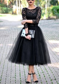 This adorable black A-line tulle skirt features full lining and an elastic mid-rise waist. Just pair it with a vintage tee and some pumps for a killer look. | Lookbook Store Date Night Style