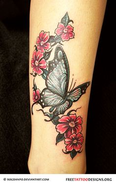 Butterfly and flowers tattoo on arm