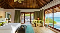 Dusit Thani Maldives: In keeping with the ocean views, rooms are decorated with white, blue and green hues.