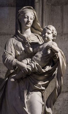 The Blessed Virgin and Child Jesus, marble statue inside the Cathedral of Notre Dame de Paris, France - French sculptor Antoine Vassé (1681-1736)