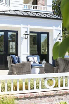 half paneled french doors California Beach House with Modern Coastal Interiors