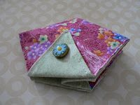 My little fabric Triangle  ThreadCatcher  sits beside my chair in the living room and also travels in my on-the-goproject box. Bec...