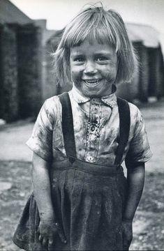 :::::::: Vintage Photograph :::::::: Sunshine through Sorrow.  Coal miner's daughter, Yorkshire, UK, 1952, by Carl Mydans