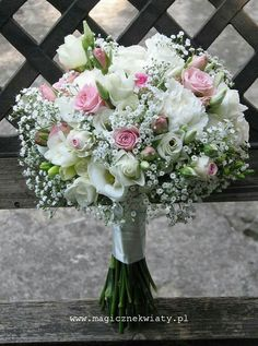 Delicate bouquet with pink roses and lovely gypsophila...
