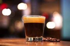 Espresso Fizz | 1 shot medium-light espresso, 3 ½ oz Fever-Tree tonic water, chilled, dash of orange bitters, 1 piece orange peel, pith removed. Add chilled tonic water, a dash of orange bitters and an orange twist to a 5-oz lowball glass. Prepare a shot of espresso. Gently pour the espresso over the back of a bar spoon into the lowball glass so that the coffee floats on top of the tonic water. Serve immediately.