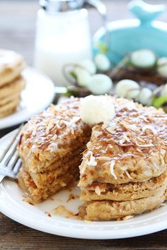 Toasted Coconut Pancakes Recipe on twopeasandtheirpod.com Light and fluffy pancakes with a sweet toasted coconut topping! These pancakes are perfect for Easter brunch!