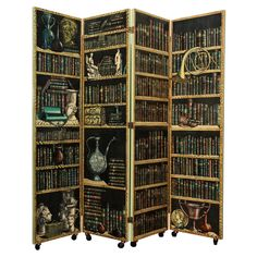"""Early 4-Panel """"Libreria"""" Folding Screen by Piero Fornasetti  Italy  c. 1951  Double sided screen of transfer-printed images over lacquered wood. One side depicting shelves with books, and objects. The other side showing Faux bois wall panels with intricate moldings."""