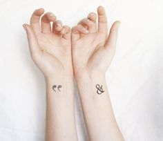 tiny  temporary tattoos perfect for wrists! modern design pack of 6 includes a tiny heart, feather, anchor, ampersand and quotation marks.