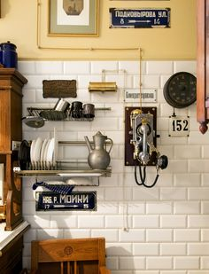 Back in the ('30s) USSR: A chrome-plated phone from a mine hangs on a kitchen wall, surrounded by St. Petersburg street signs.