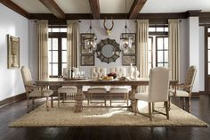 Light gray-blue and natural wood: Adding an earthly tone of gray-blue and natural wood on your dining room gives an organic dining experience. You can add crystal chandelier to deliver glitz and charm.