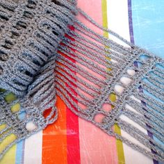 Crochet this lacy scarf in Vanna's Glamour for a spakrly accessory to wear all year round.
