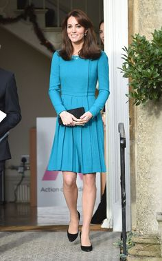 Catherine, Duchess of Cambridge looked radiant wearing the vibrant teal dress by designer Emilia Wickstead, and holding a Mulberry clutch bag.