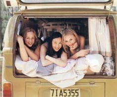 Cute girls in a VW bus.