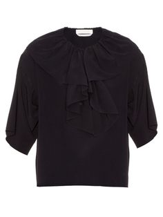 Chloé's navy crepe de Chine top exemplifies the house's sophisticated approach to bohemian silhouettes. It has a ruffled V-neckline with drawstrings and tassels, elbow-length sleeves, and a dipped, curved hemline. Wear it with wide-leg trousers for a long and lean profile.