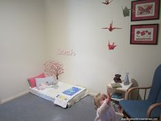toddler room... i like the crane mobile, the cube chair, and that the pillows go on the floor lest she falls