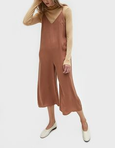 Easy jumpsuit from Stelen in Camel. V-neckline. Thin straps. Concealed back zip closure. Darts at bust. Relaxed wide leg. Cropped. Unlined. Casual fit.  • Lawn Sateen • 100% polyester • Hand wash cold