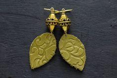 Green Leather Bohemian Earrings with Antique by MusingTreeStudios  #etsy #etsyshop #etsyseller #etsyjewelry #etsyhandmade #etsyjewelry #handmade #handmadejewelry #boho #bohemian #bohochic #bohojewelry #bohostyle #bohochicjewelry #bohemianjewelry #forsale #jewelry