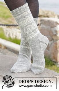 "Silver Dream Socks - Knitted DROPS socks with Norwegian pattern in ""Karisma"". Size 35 to 46 - Free pattern by DROPS Design Knitted Boot Cuffs, Knit Boots, Knitted Slippers, Drops Design, Crochet Socks, Knitting Socks, Wool Socks, Knitting Patterns Free, Free Knitting"