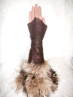 Leather fingerless gloves also known as Kittys. via Etsy.