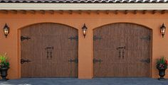 Simple design, but with great curb appeal. Faux wood garage doors that look like real wood garage doors. The beauty of real wood without the maintenance upkeep of natural wood doors