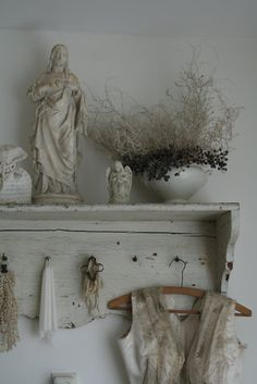 """""""Benedicte drifts through the rooms of the lower floor, into the dust of venerable scents."""" The Lantern by Deborah Lawrenson Wall Shelf Arrangement, Home Altar, Vintage Enamelware, Rustic Shelves, Shades Of White, Rustic Elegance, Religious Art, Decoration, Decorating Your Home"""