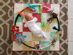 Baby sensory and tummy time activity hula hoop and anything that can be put on the hoop - jingle bells, paper, grocery bag(secured to avoid danger), ribbon, garland, pinwheel, tulle, pipecleaners (with ends bent over for safety from pointed end), bubble wrap etc.