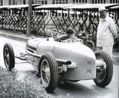 Achille Varzi at the wheel of a Type 59 and Ettore Bugatti himself.