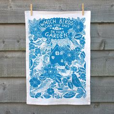 Organic cotton T-towel, hand-printed in turquoise blue or red, eco-friendly.