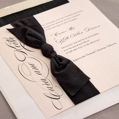 Like a beautiful party dress of soft blush-pink tied with a luxe black crepe ribbon, this ultra-romantic design promises unforgettable elegagance-Available at Note Worthy from Checkerboard. Wedding Invitations